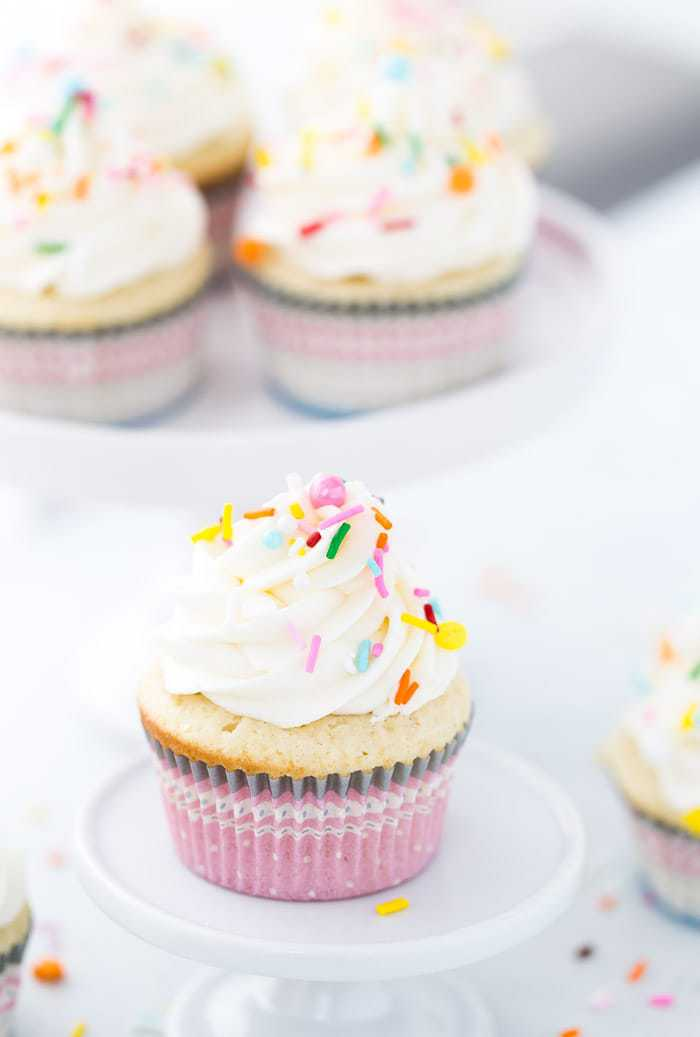 These vanilla cupcakes with cream cheese frosting are moist, light and crumbly. It is a simple and classic cupcake recipe everyone needs!