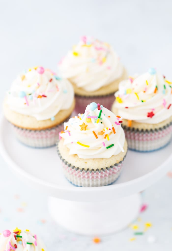 These vanilla cupcakes with cream cheese frosting are moist, light and crumbly.