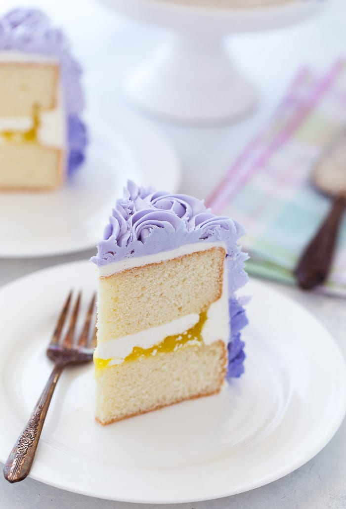 A classic lemon layer cake recipe with a moist, tender lemon cake filled with lemon zest and fresh lemon juices. The cake is dressed in a beautiful ombre lemon buttercream perfect for Spring entertaining.