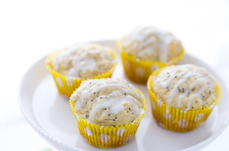 Lemon poppy seed muffins are moist and packed with fresh lemon zest and juice. These lemon poppy seed muffins are what every breakfast should be made of! | Recipe on BlahnikBaker.com