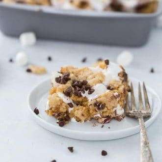 These classic s'mores cookie bars are ooey-gooey perfection with a graham cracker cookie dough crust filled with marshmallow fluff and chocolate squares.