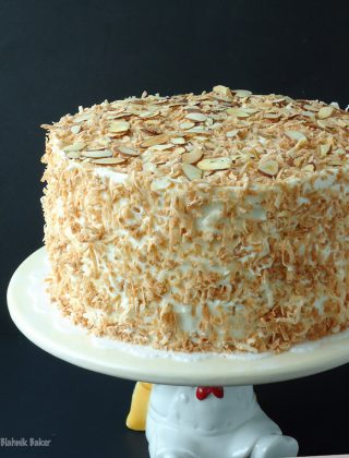 Coconut Almond Cream Cake is a coconut lover's dream cake and the perfect Easter dessert recipe. Coconut cake, almond cream filling, and coconut frosting! | BlahnikBaker.com