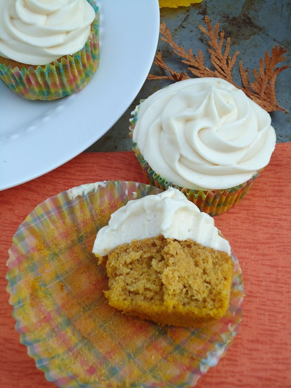 These pumpkin spice cupcakes are moist, flavorful and loaded with warm spices of the fall. Caramel cream cheese frosting makes this recipe a fall must-have. | www.blahnikbaker.com