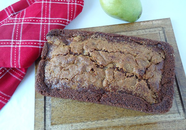 This spiced pear bread is moist, flavorful and delicious! Filled with homemade applesauce, walnuts and pears, it is seriously the best quick bread recipe.