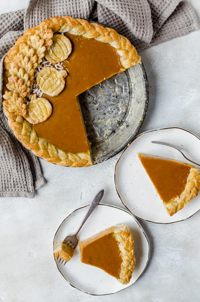 Creamy and delicious pumpkin coconut pie istopped with toasted coconut flakes. You will want this on your Thanksgiving table!
