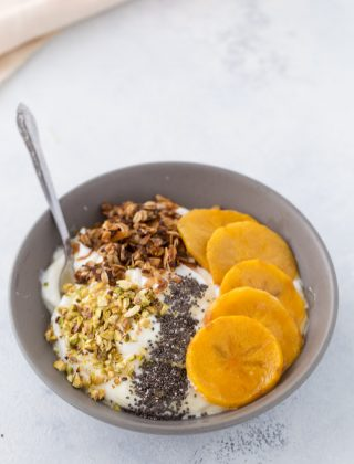 This roasted persimmon yogurt bowl is a quick and easy breakfast bowl full of winter flavors.