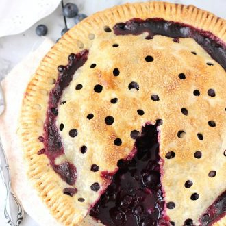 A classic blueberry pie recipe with a buttery flaky crust, fresh blueberries and fresh lemon juice. This recipe is summer perfect!