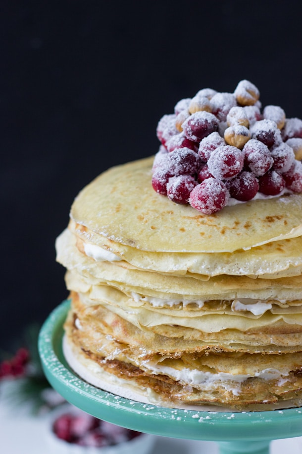 A stunning and simple cranberry hazelnut crepe cake!