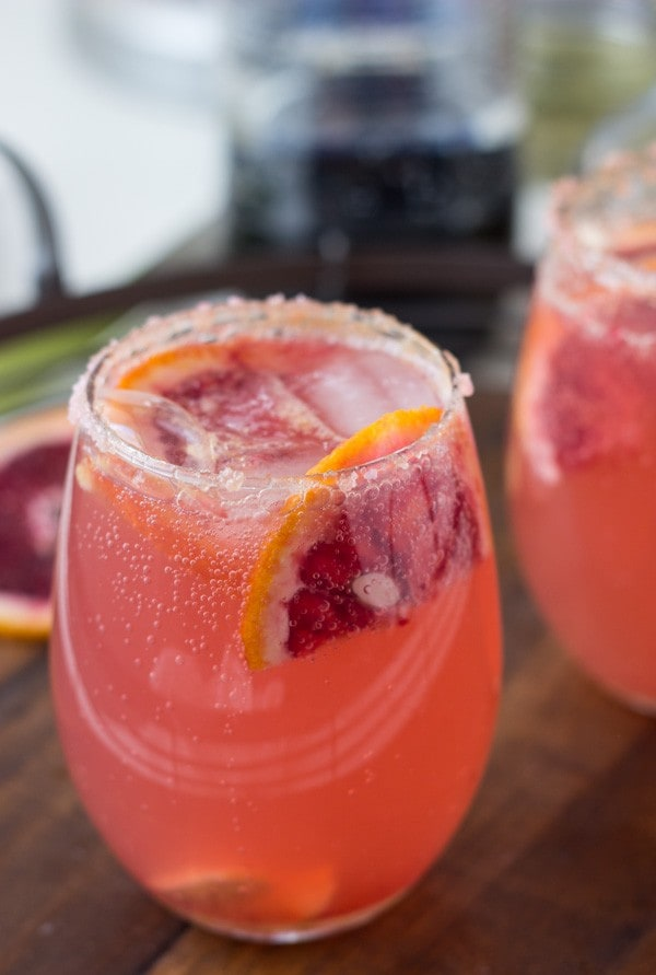 Recipes for two sparkling grapefruit cocktails to get you started on your parties; a grapefruit rosemary sparkler and a grapefruit ginger-orange cocktail!