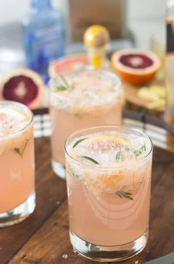 Sparking grapefruit cocktails are the perfect holiday brunch cocktail! Sparkling Grapefruit Rosemary Cocktail- refreshing and delicious!