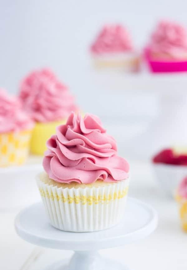 Raspberry Lemon Cupcakes - fresh lemon cupcakes filled with raspberry lemon curd and topped with a fluffy raspberry frosting.
