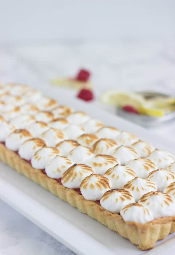 Raspberry Lemon Meringue Tart - A buttery pastry crust filled with sweet and tart raspberry lemon curd and topped with a fluffy toasted meringue.