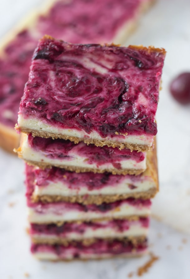 A sweet cheesecake filling is topped with a tart cherry swirl in these cherry lime cheesecake bars