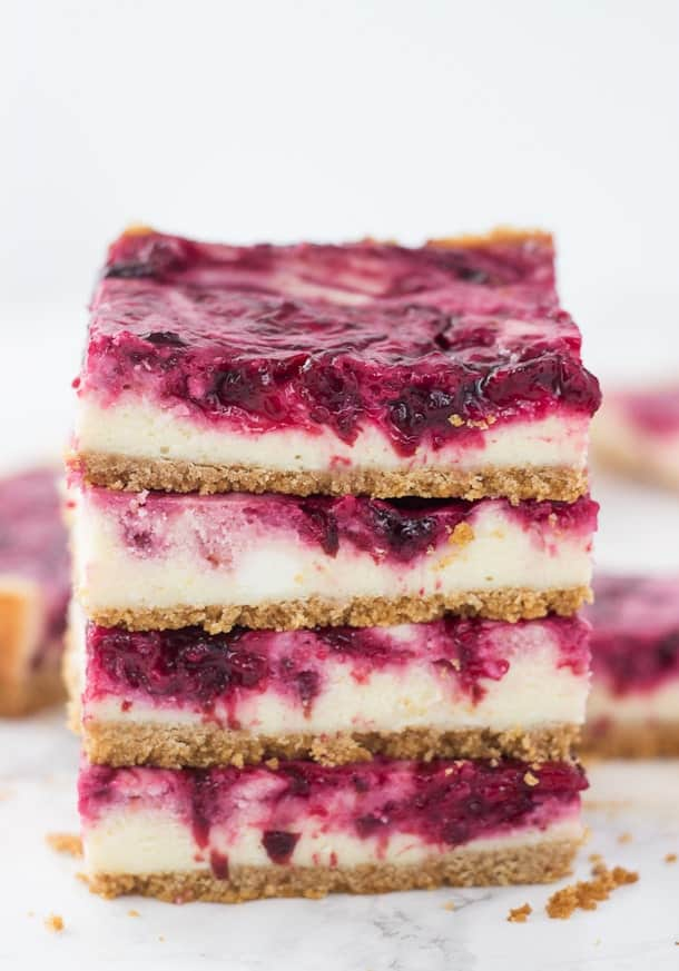 A sweet cheesecake filling is topped with a tart cherry swirl in these cherry lime cheesecake bars  via Blahnik Baker