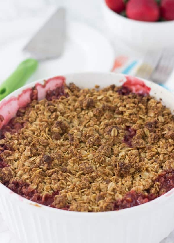 This strawberry raspberry rhubarb crumble is bursting with sweet and tart juices on the inside and topped with a gluten-free coconut oatmeal crumb topping.