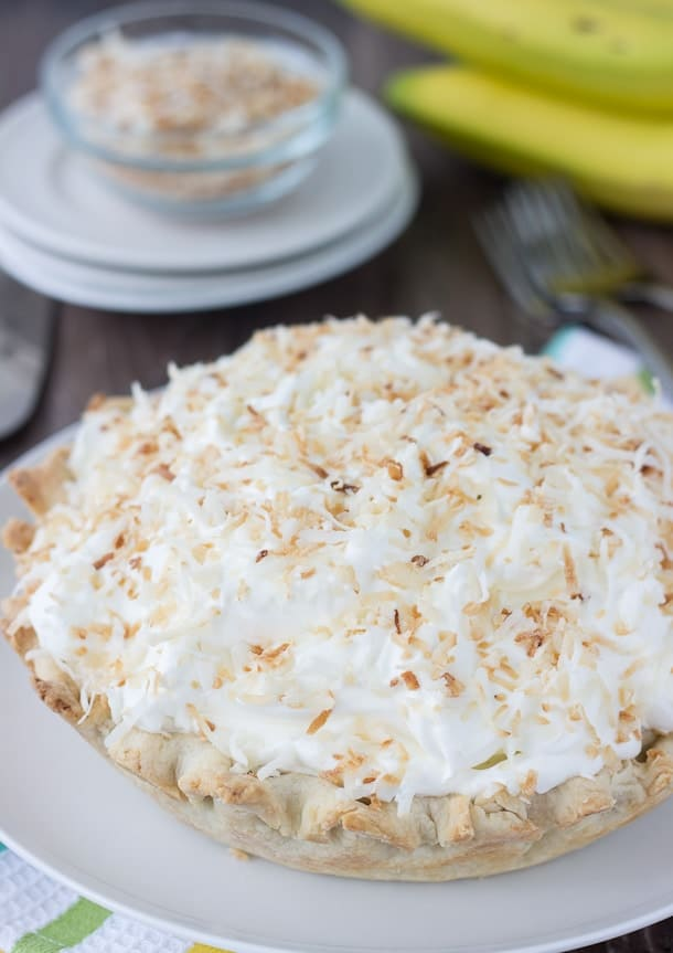 This coconut banana cream pie takes your favorite classic banana cream pie recipe a notch with a coconut crust and toasted coconut.