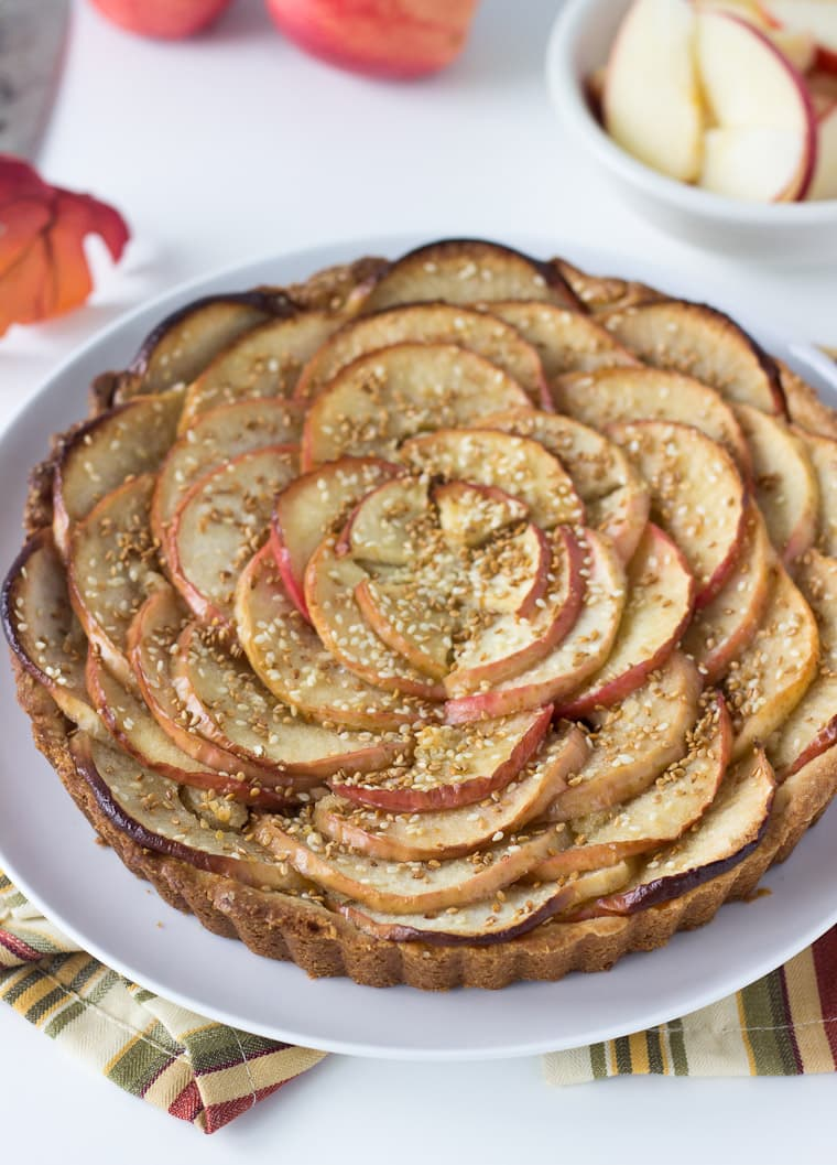 A sweet tart dough, nutty frangipane filling and toasted sesame seeds makes this apple tart recipe a winner.