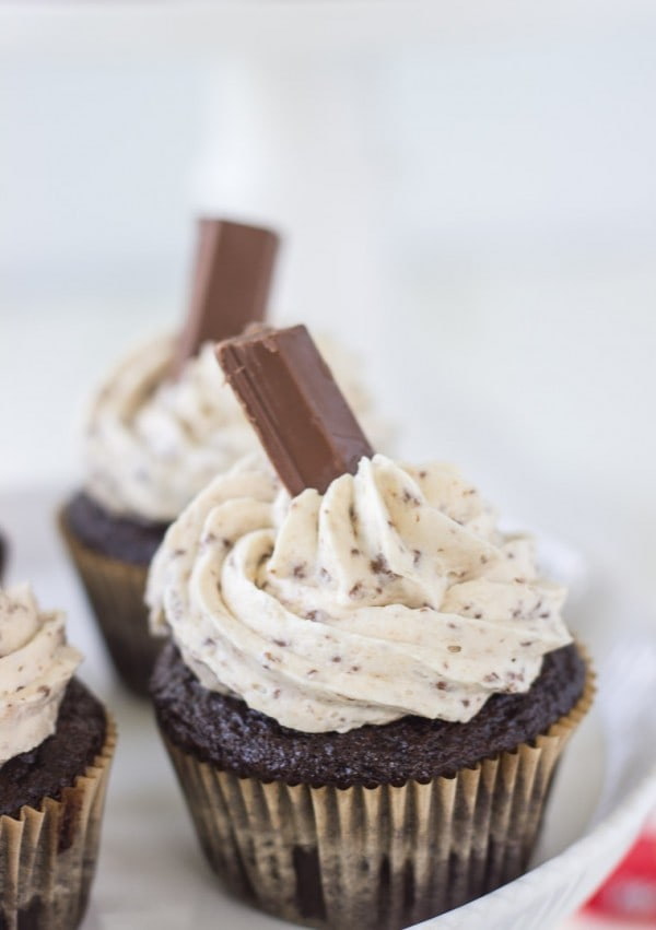 A moist chocolate cupcake with a whipped kit kat buttercream makes these Kit Kat Cupcakes a great Halloween treat!