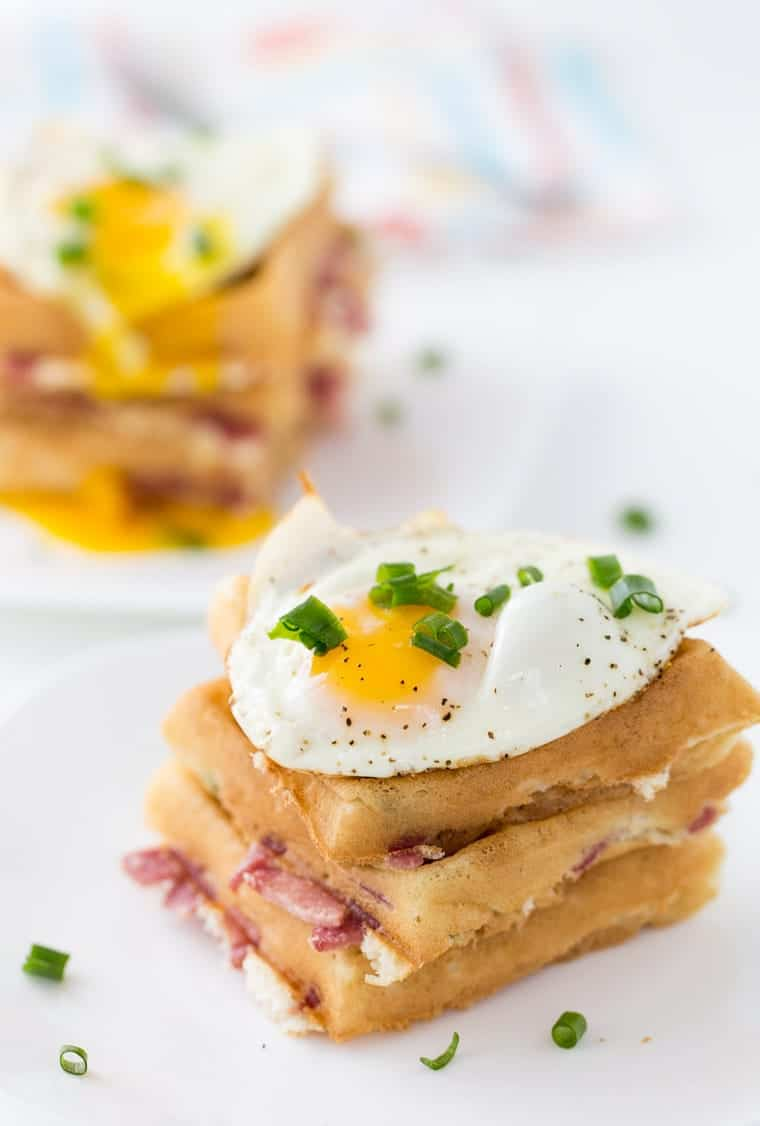 These cheddar and bacon waffles are perfect recipe for breakfast nights and brunch. With soft buttermilk waffles filled with cheddar cheese, bacon and topped with an egg.