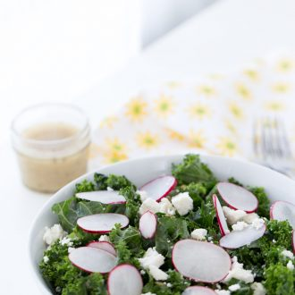 A simple and delicious homemade kale salad with radishes, pepitas, cojita cheese and lime vinaigrette. Light and fresh for a side dish or meal.