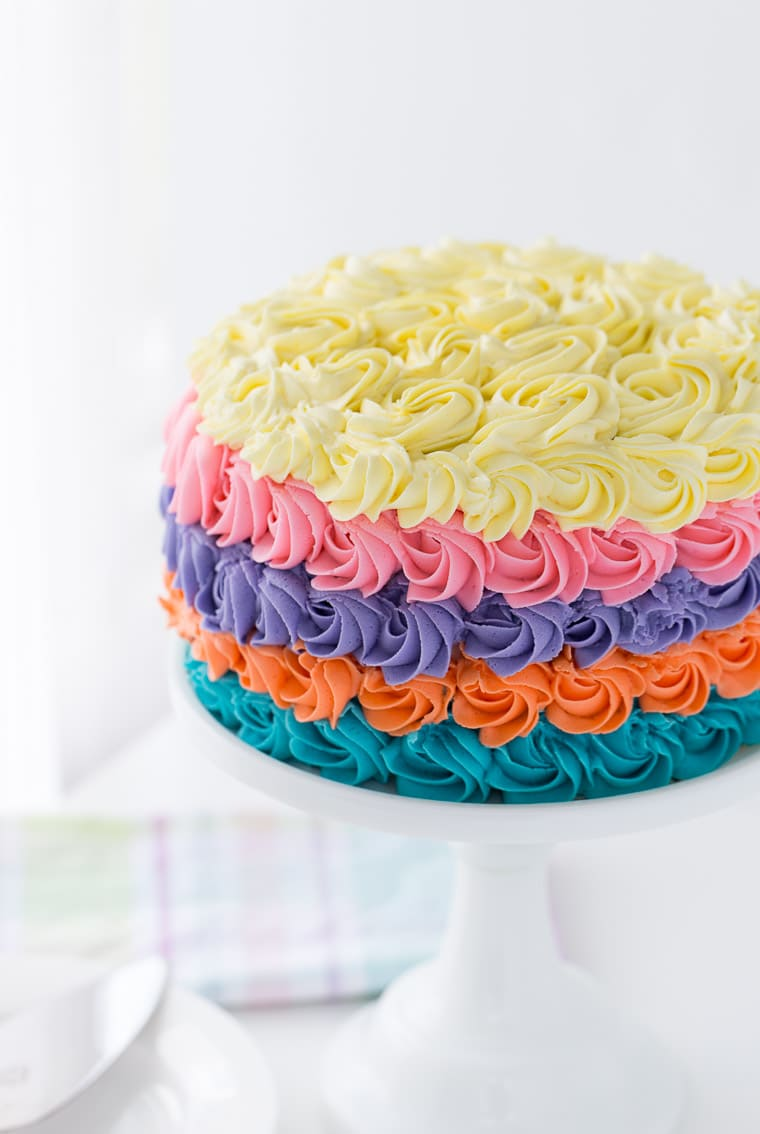 This strawberry rainbow cake is a pretty birthday cake for any girl! With a homemade strawberry cake and whipped vanilla buttercream in colorful swirls.