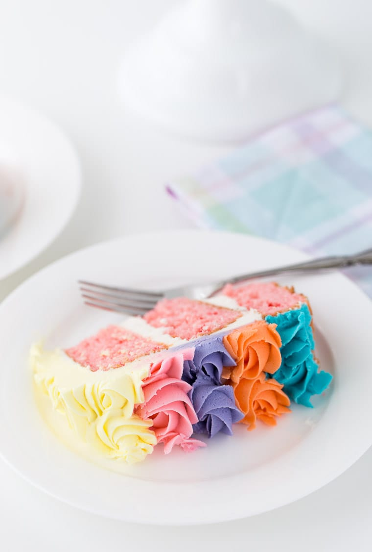 This strawberry rainbow cake is a pretty birthday cake for any girl! With a homemade strawberry cake and whipped vanilla buttercream in colorful swirls