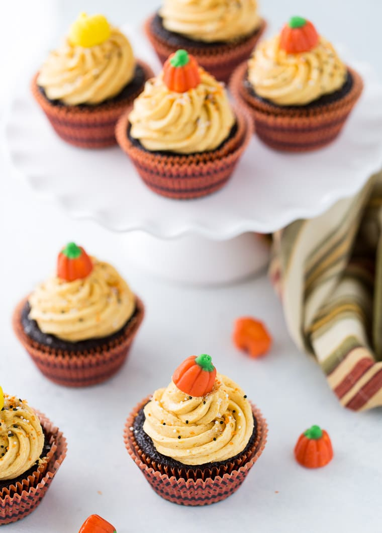 These chocolate pumpkin cupcakes are rich, decadent chocolate cupcakes with an irresistible pumpkin pie frosting.