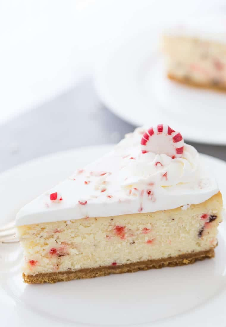 This peppermint white chocolate cheesecake recipe is creamy with white chocolate filling, crunchy peppermint chocolate bark and topped with whipped cream.
