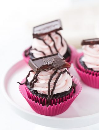 These chocolate strawberry cupcakes are perfect for your Valentine! Decadent dark chocolate cupcakes topped with a whipped fresh strawberry frosting.