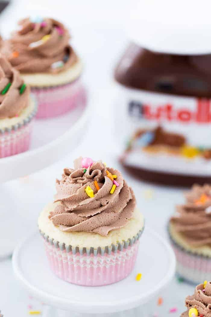 These vanilla cupcakes with nutella frosting are moist, nutty and topped with a whipped nutella buttercream that is creamy delicious.
