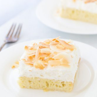 This Coconut Tres Leches Cake is your classic tres leche cake oozing with sweet coconut milk, dark rum and a fresh whipped coconut cream.
