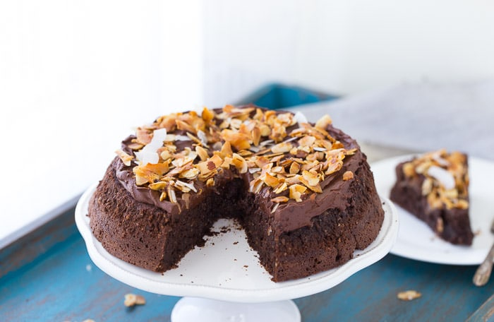 This flourless chocolate coconut cake has a decadent chocolate cake topped with whipped chocolate ganache and a crunchy coconut almond topping.