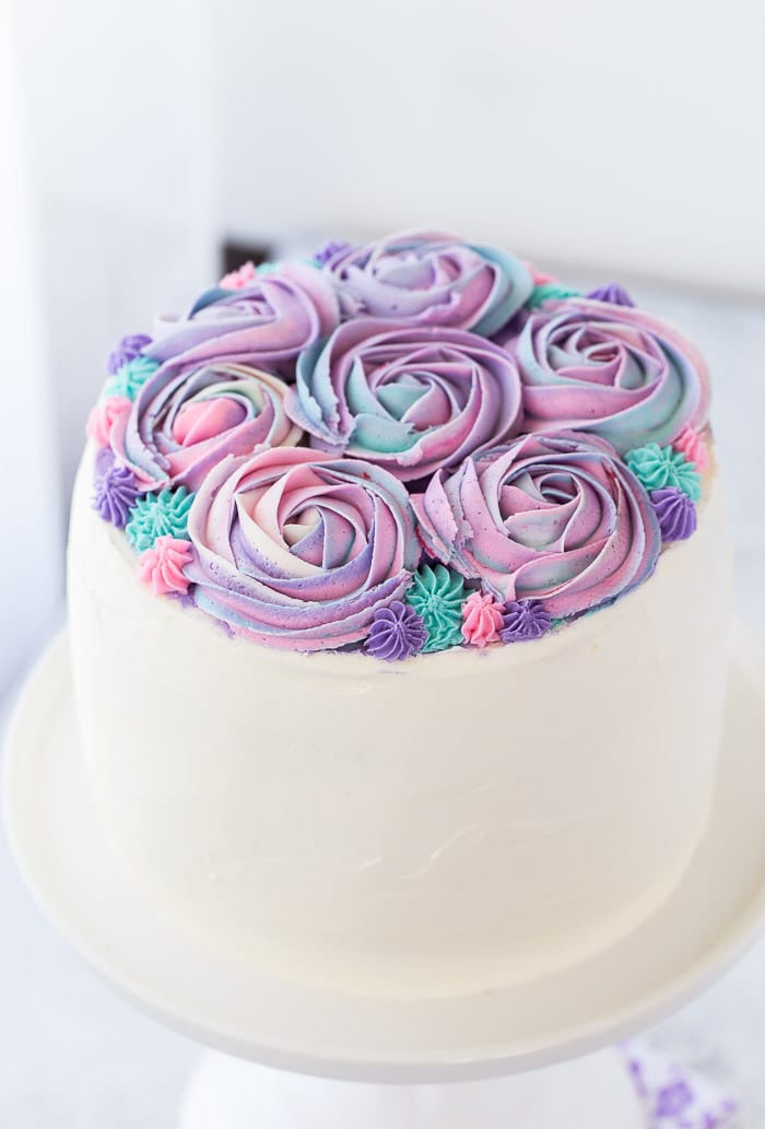 This white chocolate rose cake is an incredibly moist vanilla bean cake with hints of floral rose water and whipped white chocolate frosting.