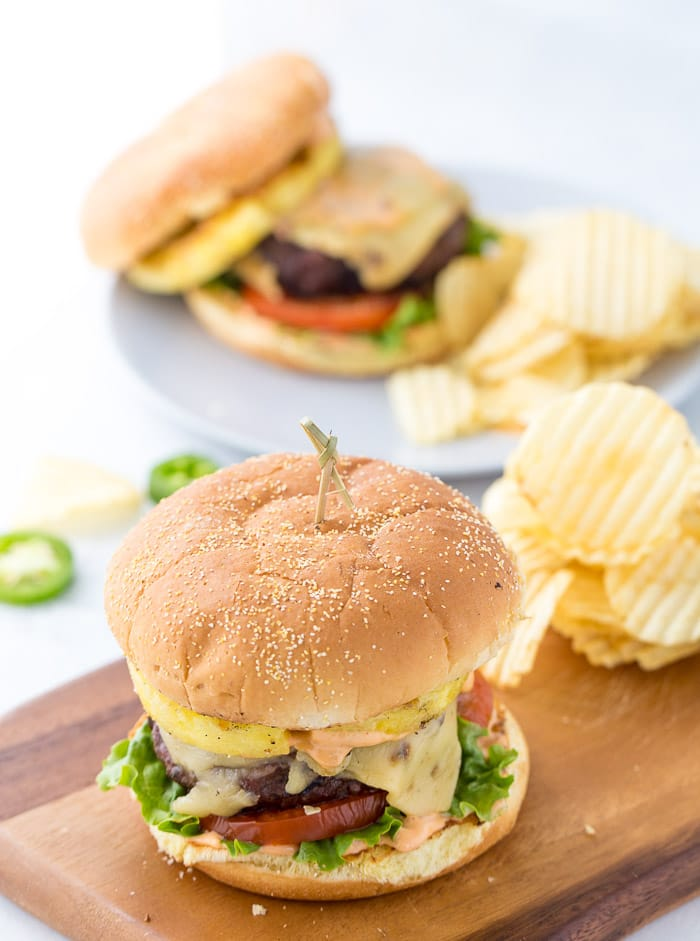 These pineapple jalapeno burgers are topped with pepper jack cheese, chipotle mayo, grilled pineapples and jalapenos. Each bite is packed with flavors and you will be reaching for more this summer.
