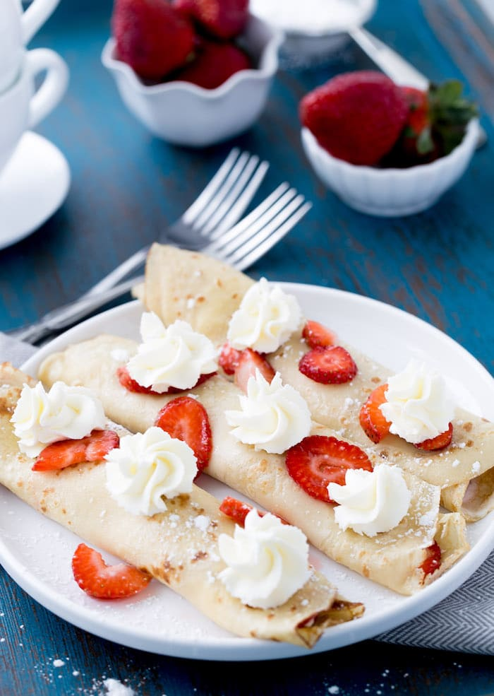 These sweet strawberry mascarpone crepes are filled with creamy Italian mascarpone cheese and macerated strawberries. They are perfect for brunch!
