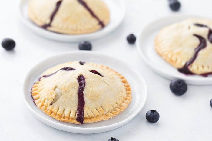 Classic blueberry hand pies with a flaky buttery crust filled with warm juicy blueberry filling and a dollop of cream cheese. It's simply amazing.