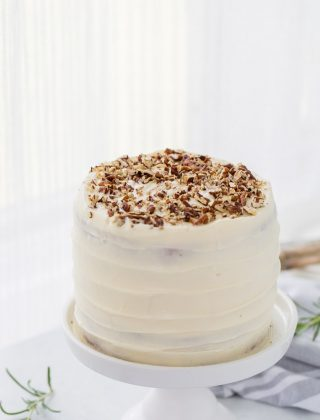 A classic hummingbird cake with a pineapple, banana and pecan spiced cake topped with cream cheese frosting. A moist spiced cake full of bold flavors.