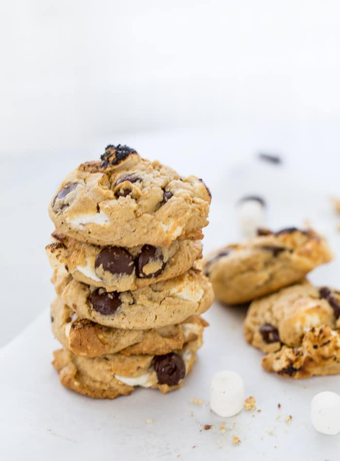 These S'mores Chocolate Chip Cookies are ooey-gooey perfection with a graham cracker cookie base filled with chocolate chips and mini marshmallows.