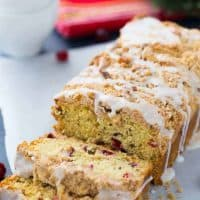 This Cranberry Orange Coffee Cake is a moist crumb cake that will brighten up any cold winter night! Get the quick and easy coffee cake recipe here!