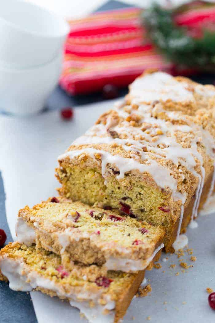 This Cranberry Orange Coffee Cake is a moist crumb cake that will brighten up any cold winter night! Get the quick and easy coffee cake recipe here! #coffeecake #cranberry #cake #dessert
