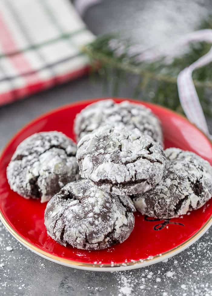These Mexican chocolate crinkle cookies are a spiced up version of your traditional crinkle cookies. Decadent, chewy and spiced with warm cinnamon.