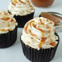 Dark Chocolate Salted Caramel Cupcakes - A decadent chocolate cupcake with salted caramel drizzled over mocha buttercream frosting. | BlahnikBaker.com