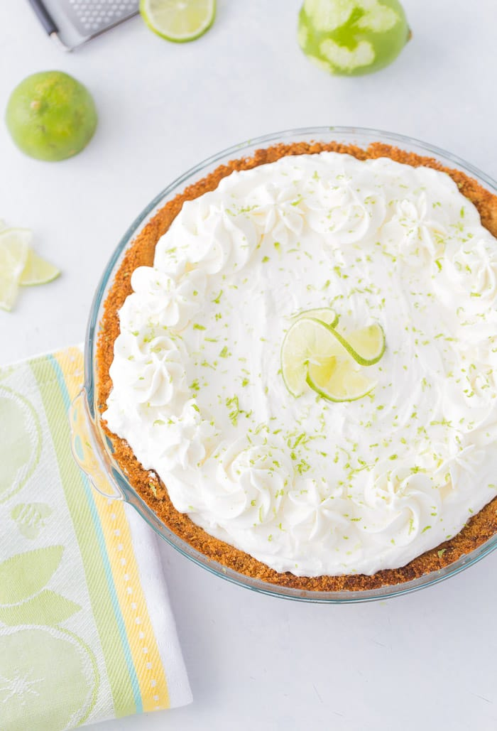 This no bake frozen margarita pie recipe is sweet, tangy and refreshing. Creamy cream cheese and tart lime juice in the perfect summer pie.