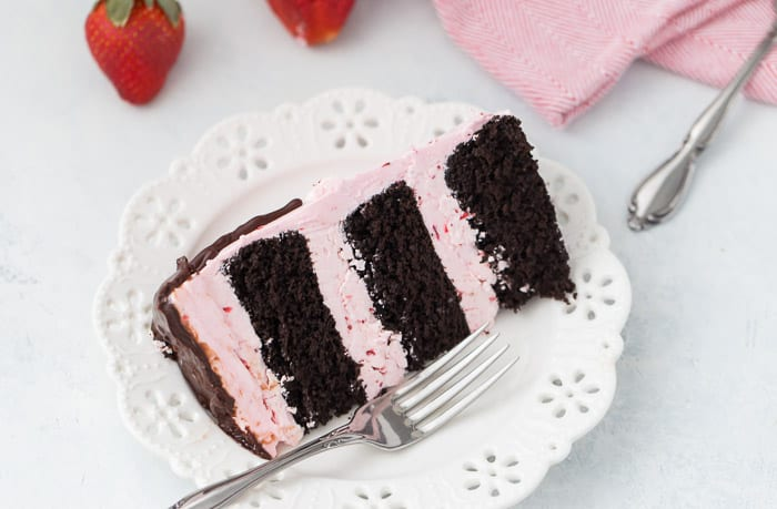 This dark chocolate strawberry cake is a great summer celebration cake for the chocolate and strawberry lovers alike. A decadent dark chocolate cake is filled with a light and fluffy fresh strawberry buttercream.