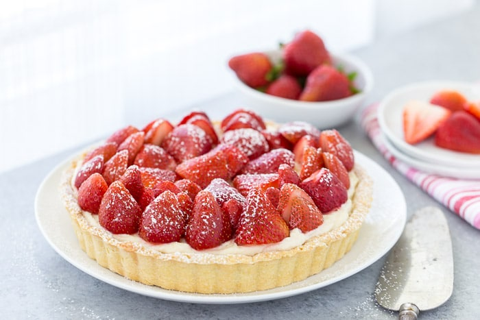 This strawberry mascarpone tart is a beautiful 3-layered tart with a buttery crust and a creamy lemon mascarpone filling topped with fresh strawberries.
