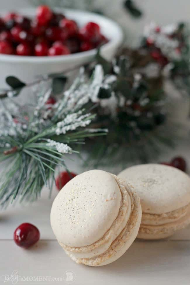 These orange walnut macarons are fun and seasonal and are filled with a subtly Spiced Cinnamon Cream Cheese Frosting and Fresh Cranberry Compote.