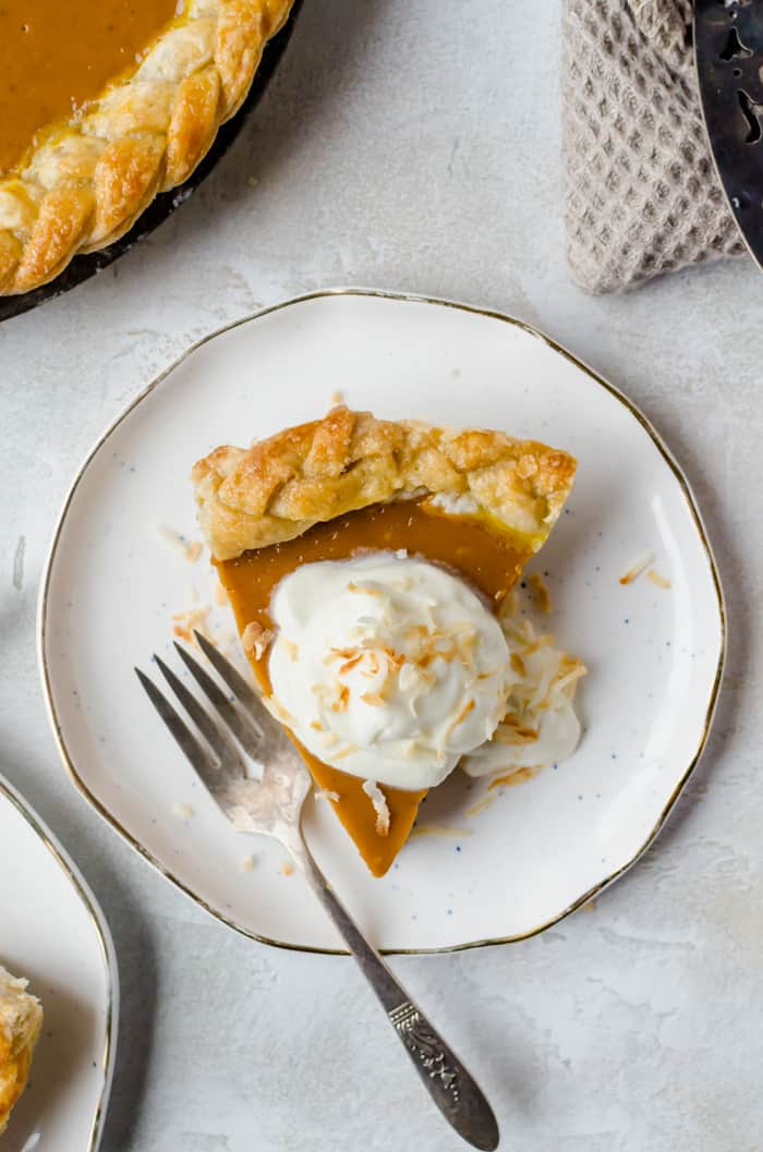 Creamy and delicious pumpkin coconut pie is topped with toasted coconut flakes. You will want this on your Thanksgiving table!