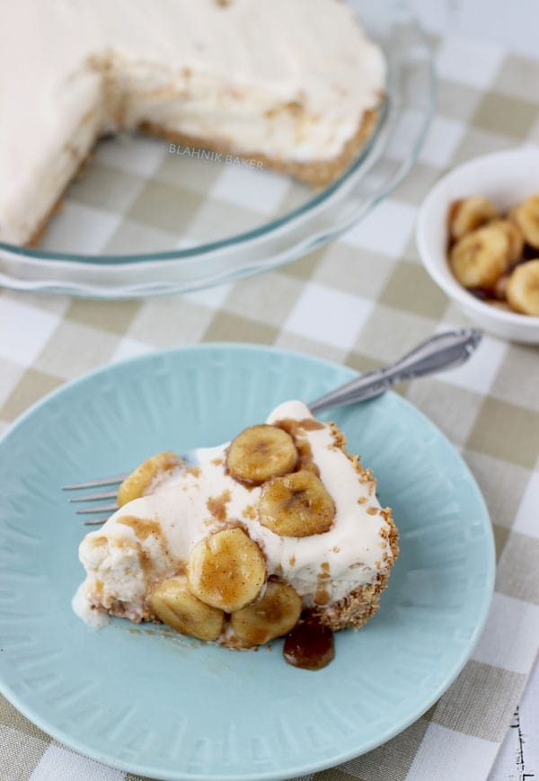 Pecan praline ice cream on top of a graham cracker crust is topped off with brown butter and brown sugar caramelized bananas in this classic banana foster pie.