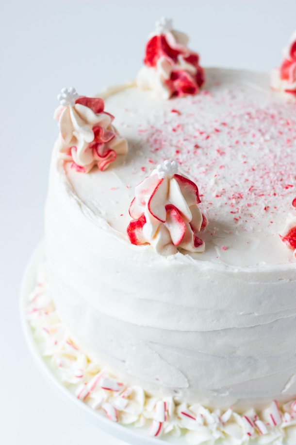 Peppermint White Chocolate Cake - a moist white chocolate cake layered in a cool peppermint whipped frosting!