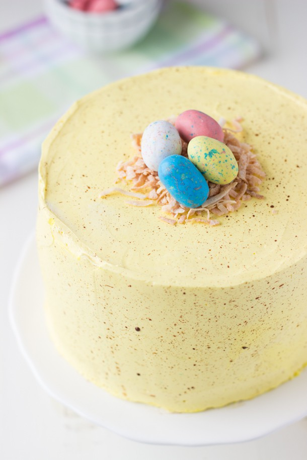 Easter Speckled Egg Cake - a soft coconut lemon layer cake recipe decorated as an Easter speckled egg.